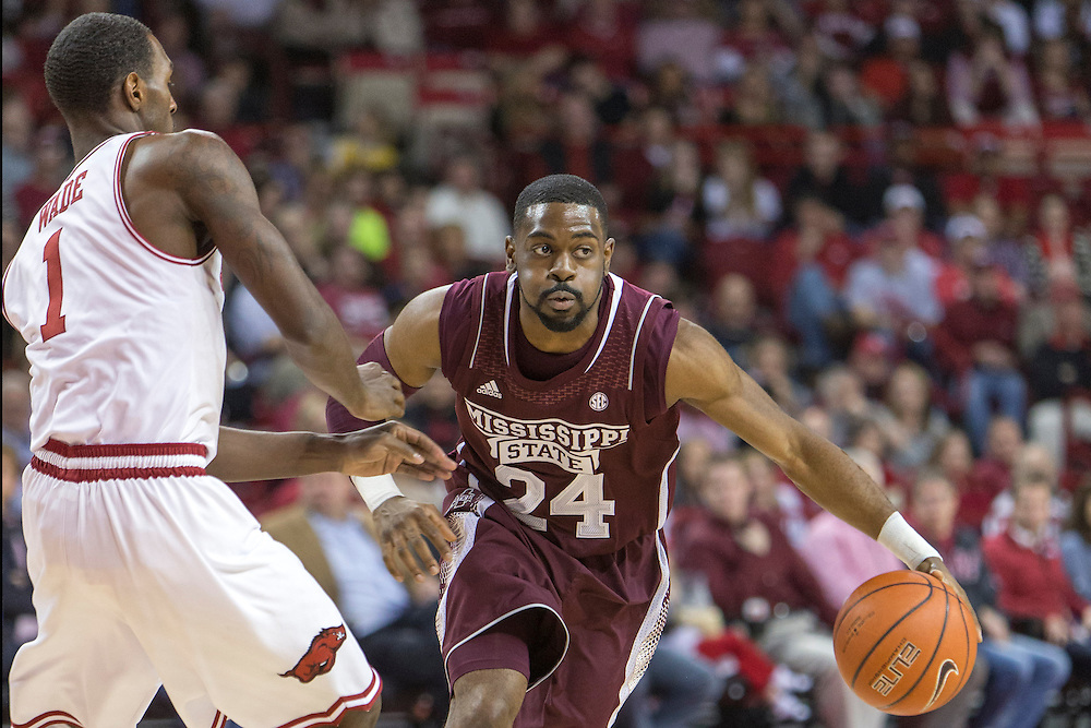 FAYETTEVILLE, AR - JANUARY 23:  Tyson Cunningham #24 of the Mississippi State Bulldogs dribbles the ball down the court against the Arkansas Razorbacks at Bud Walton Arena on January 23, 2013 in Fayetteville, Arkansas. The Razorbacks defeated the Bulldogs 96-70.  (Photo by Wesley Hitt/Getty Images) *** Local Caption *** Tyson Cunningham