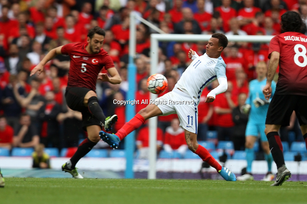 22.05.2016. Etihad Stadium, Manchester, England. International football friendly match, England versus Turkey. Delle Ali of England and Calhanoglu of Turkey compete for possession.