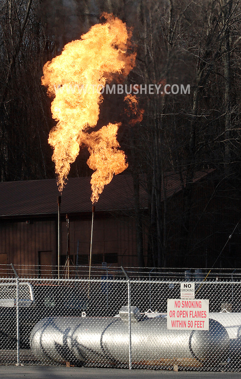 South Fallsburg, NY - Flames rise from a controlled propane tank burnoff at Fallsburg Gas on Nov. 16, 2009.