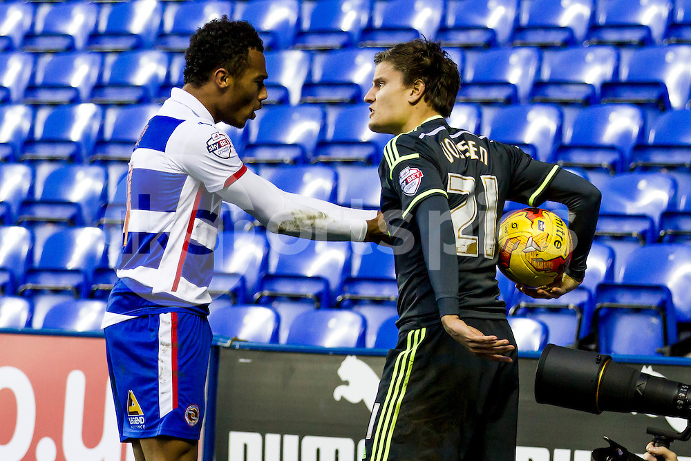 Tempers get heated during the 1-1 draw between Jordan Obita of Reading and Jelle Vossen of Middlesbrough  during the Sky Bet Championship match between Reading and Middlesbrough at the Madejski Stadium, Reading, England on 10 January 2015. Photo by Gareth  Brown.