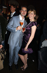 JIMMY CARR and KAROLINE COPPING at a party hosted by Dom Perignon at Sketch, Conduit Street, London on 18th October 2006.<br />