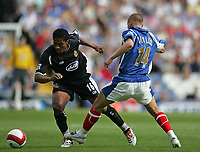 Photo: Lee Earle.<br /> Portsmouth v Wigan Athletic. The Barclays Premiership. 09/09/2006. Wigan's Louis Antonio Valencia (L) skips dribbles past Matthew Taylor.