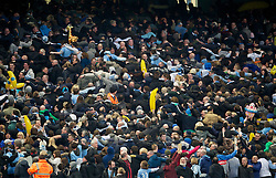 MANCHESTER, ENGLAND - Sunday, March 13, 2011: Manchester City supporters turn their back on the match to mimic the Poznan fans as they celebrate their side's 1-0 victory over Reading during the FA Cup 6th Round match at the City of Manchester Stadium. (Photo by David Rawcliffe/Propaganda)