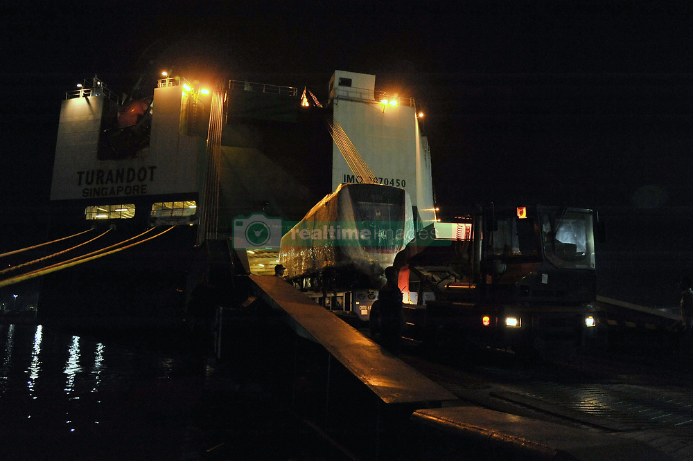 April 13, 2018 - Jakarta, Indonesia - A train set of Light Rail Transit (LRT) pulls out from the cargo ship upon arrival at Tanjung Priok Car Terminal in Jakarta, Indonesia on April 14, 2018. One LRT train set consist of two train carriages with estimation load 278 passengers. It was made by Hyundai Roterm in Changwon, South Korea and shipped from Masan port since 24 March 2018. (Credit Image: © Anton Raharjo/NurPhoto via ZUMA Press)