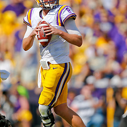 Oct 12, 2013; Baton Rouge, LA, USA; LSU Tigers quarterback Zach Mettenberger (8) against the Florida Gators during the first quarter of a game at Tiger Stadium. Mandatory Credit: Derick E. Hingle-USA TODAY Sports