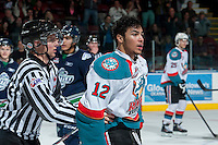 KELOWNA, CANADA -FEBRUARY 10: Tyrell Goulbourne #12 of the Kelowna Rockets is escorted off the ice after dropping the gloves in the final moments of the third period with Jared Hauf #33 of the Seattle Thunderbirds on February 10, 2014 at Prospera Place in Kelowna, British Columbia, Canada.   (Photo by Marissa Baecker/Getty Images)  *** Local Caption *** Tyrell Goulbourne;