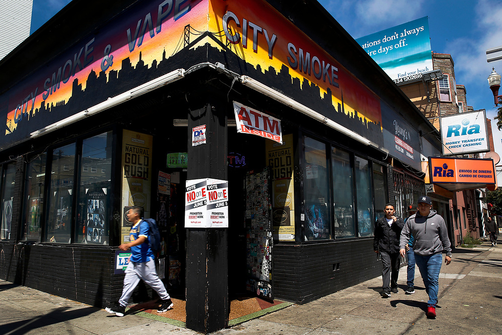 City Smoke Shop, Tuesday, May 8, 2018, in San Francisco, Calif. The shop displays a sign against Proposition E, which would prevent the sale of products like flavored tobacco and menthol cigarettes.