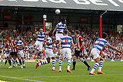 QPR defender Alex John-Baptiste (20) heads clear during the EFL Sky Bet Championship match between Brentford and Queens Park Rangers at Griffin Park, London, England on 21 April 2018. Picture by Andy Walter.