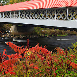 Built in 1864, the 159-foot Ashuelot Covered bridge spans the Ashuelot River in Ashuelot, New Hampshire. Fall.