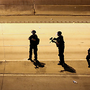 Charlotte, NC- September 22, 2016: Charlotte Mecklenburg police officers point guns loaded with non-lethal rounds toward protestors in attempts to remove them from Interstate 277.  CREDIT: LOGAN R. CYRUS FOR THE NEW YORK TIMES