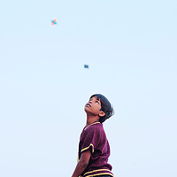 Boys flying kites in the ghats