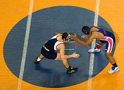 Jacoby Johnson of Liberty University wrestles David Mendoza of Old Dominion University in the 197lb weight class.  The 2008 Virginia Intercollegiate Wresting Championships were hosted by the University of Virginia at the John Paul Jones Arena in Charlottesville, VA on January 5, 2008.