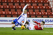 Walsall's Jason Demetriou is brought down by Swindon Town's Ben Gladwin during the Sky Bet League 1 match between Swindon Town and Walsall at the County Ground, Swindon, England on 24 November 2015. Photo by Shane Healey.