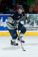 KELOWNA, CANADA -FEBRUARY 10: Adam Henry #4 of the Seattle Thunderbirds skates with the puck against the Kelowna Rockets on February 10, 2014 at Prospera Place in Kelowna, British Columbia, Canada.   (Photo by Marissa Baecker/Getty Images)  *** Local Caption *** Adam Henry;
