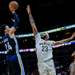 Jan 20, 2018; New Orleans, LA, USA; Memphis Grizzlies forward Dillon Brooks (24) shoots over New Orleans Pelicans forward Anthony Davis (23) and center DeMarcus Cousins (0) during the first half at the Smoothie King Center. Mandatory Credit: Derick E. Hingle-USA TODAY Sports