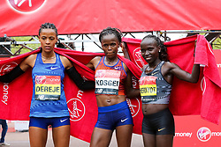 © Licensed to London News Pictures. 28/04/2019. London, UK. Roza Dereje of Ethiopia (L), Brigid Kosgei of Kenya (C) and Vivian Cheruiyot of Kenya (R) the winners of the women's race at the London Marathon 2019. Photo credit: Dinendra Haria/LNP