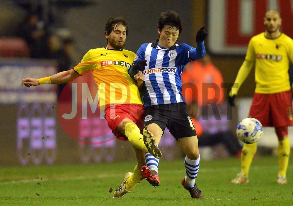 Watford's Gianni Munari challenges Wigan's Kim Bo-Kyung - Photo mandatory by-line: Richard Martin-Roberts/JMP - Mobile: 07966 386802 - 17/03/2015 - SPORT - Football - Wigan - DW Stadium - Wigan Athletic  v Watford - Sky Bet Championship