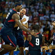 United States men's basketball players LeBron James, left, Deron Williams, second from left, Dwayne Wade, second from right and Carlos Boozer, right, celebrate the USA victory in the gold medal game against Spain on August 24, 2008 at the 2008 Summer Olympic Games in Beijing, China. (photo by David Eulitt/The Kansas City Star/MCT).