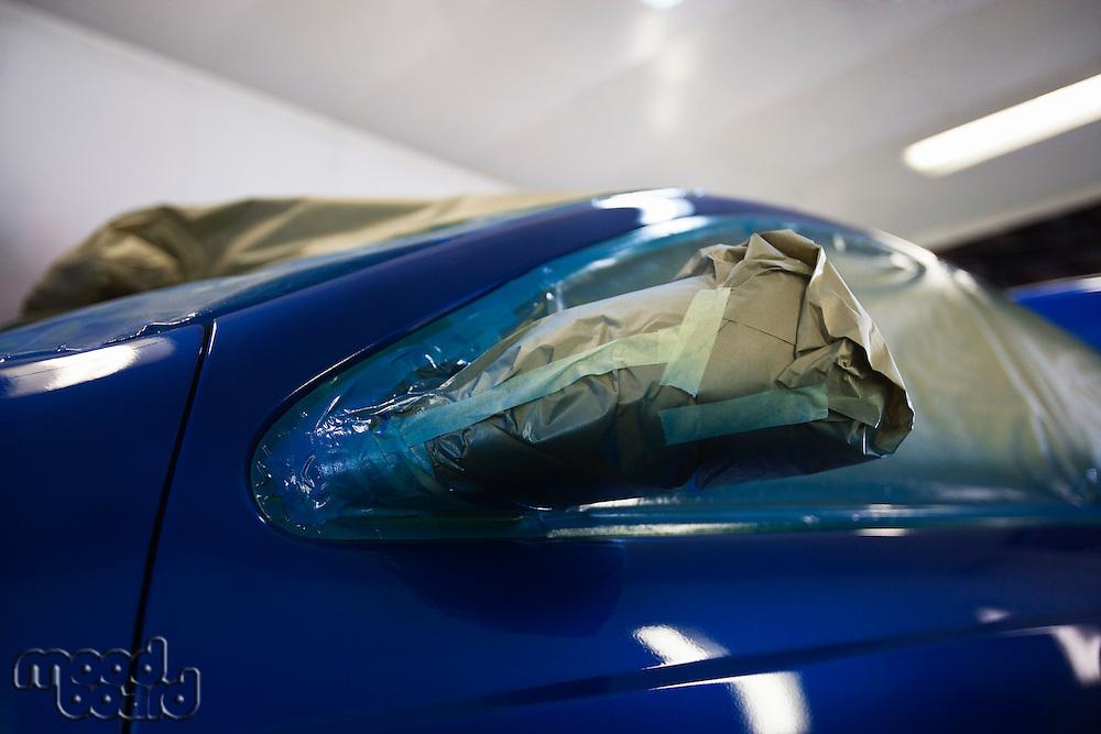 Damaged headlight of blue car