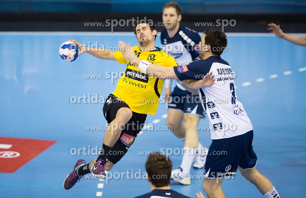 Luka Dobelsek of Gorenje vs Tobias Karlsson of SG Flensburg-Handewitt during the handball match between RK Gorenje Velenje and SG Flensburg-Handewitt (GER) in 10th Round of EHF Champions League 2013/14 on February 22, 2014 in Rdeca dvorana, Velenje, Slovenia.  *** Local Caption *** &Atilde;'&Acirc;&copy; pixathlon<br /> <br /> FRA out ! FRA out!