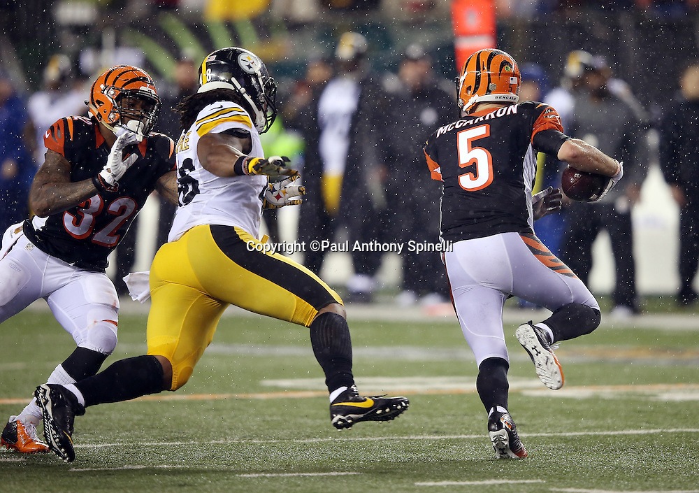 Cincinnati Bengals quarterback AJ McCarron (5) gets a block on pursuing Pittsburgh Steelers outside linebacker Bud Dupree (48) from Cincinnati Bengals running back Jeremy Hill (32) as McCarron rolls right and throws a fourth quarter desperation pass at the end of the NFL AFC Wild Card playoff football game against the Pittsburgh Steelers on Saturday, Jan. 9, 2016 in Cincinnati. The Steelers won the game 18-16. (©Paul Anthony Spinelli)