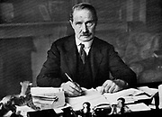 Arthur Bonar Law (1858-1923) Canadian-born Scottish Unionist statesman. British Prime Minister 1922-1923. Bonar Law at his desk.