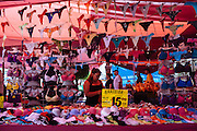 A woman sells female underwear in one of the 45 informal markets that are placed by the streets of Ciudad Nezahualcoyotl, March 31, 2011.