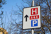 Road traffic sign directing people to University Hospital Lewisham, accident and emergency department and parking in Lewisham hospital, London, UK.