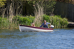 Hambleden Lock, Buckinghamshire, England. Actor, comedian and political activist Russell Brand is spotted taking his girlfriend Laura Gallacher for a boat ride along the River Thames at Hambleden. He later is alleged to have assaulted the photographer and robbed him of his spectacles, demanding that the pictures be deleted. Photographers are under no obligation to delete pictures taken of people in public. PICTURED: Brand and Gallacher enjoy the sunshine on the River Thames. &copy;Paul Davey<br /> FOR LICENCING CONTACT: Paul Davey +44 (0) 7966 016 296 paul@pauldaveycreative.co.uk
