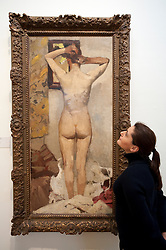 Visitor looking at painting Standing Nude by George Hendrik Breitner at Royal Museum for Fine Arts in Antwerp Belgium