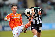 Luton Town's Dan Potts foot and Plymouth Argyle's Oscar Threlkeld's head makes contact with the ball at the same time during the Sky Bet League 2 match between Plymouth Argyle and Luton Town at Home Park, Plymouth, England on 19 March 2016. Photo by Graham Hunt.