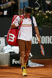 May 18, 2018 - Rome, Rome, Italy - 18th May 2018, Foro Italico, Rome, Italy; Italian Open Tennis; Kei Nishikori (JPN) dejected after losing his quater-final match 6-2, 1-6, 3-6 against Novak Djokovic (SRB). Credit: Giampiero Sposito/Pacific Press (Credit Image: © Giampiero Sposito/Pacific Press via ZUMA Wire)