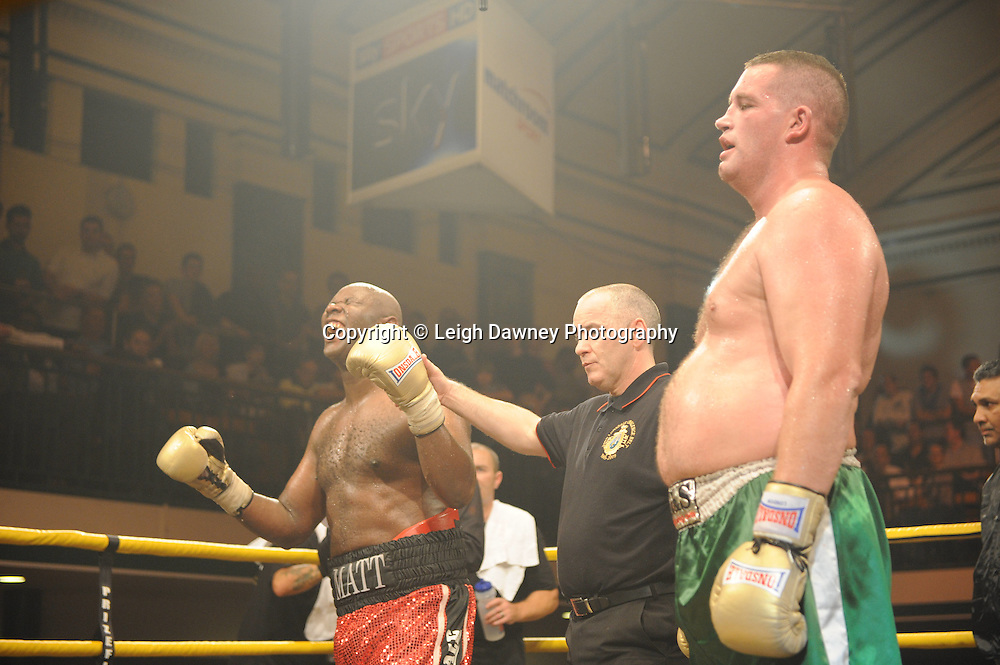 Matt Skelton (red shorts) defeats Kevin McBride at Prizefighter The Heavyweights 9th Ocrtober 2010 at York Hall, Bethnal Green, London. Prizefighter/Matchroom Sport. Barry & Eddie Hearn © Photo credit: Leigh Dawney