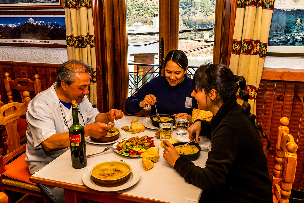 "The staff at restaurant ""Mason La Fragua"" eat a late lunch after the clients have eaten, in Trevelez, the highest village in Spain, in the Alpujarra, Sierra Nevada Mountains, Granada Province, Andalusia, Spain."