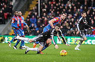 Oscar of Chelsea is felled by Scott Dann of Crystal Palace during the Barclays Premier League match between Crystal Palace and Chelsea at Selhurst Park, London, England on 3 January 2016. Photo by Ken Sparks.