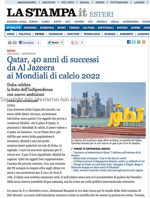 Tearsheet from La Stampa, Italy; Doha skyline
