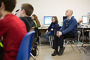 Matt Townsley, Director of Instruction and Technology at Solon Community Schools in Solon, Iowa, observes students at work in a technology class on Tuesday, March 8, 2016.