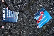 Frankfurt am Main | 26 Apr 2014<br /> <br /> Am Samstag (26.04.2014) veranstalten Aktivisten der rechtspopulistischen AfD (Alternative f&uuml;r Deutschland) auf der Leipziger Stra&szlig;e in Frankfurt-Bockenheim einen Infostand, sie versuchen, Infomaterial und Flugbl&auml;tter an Passanten zu verteilen, um f&uuml;r die Partei im laufenden Europawahlkampf zu werben.<br /> Die AfD-Wahlk&auml;mpfer werden durchgehend von etwa 50 linksradikalen Aktivisten gest&ouml;rt und behindert.<br /> hier: Viele Passanten haben die Info-Schriften der AfD-Aktivisten entgegengenommen, zerrissen und auf den Boden geworfen. <br /> <br /> &copy;peter-juelich.com<br /> <br /> [No Model Release | No Property Release]