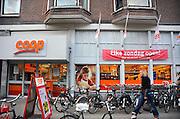 Nederland, Nijmegen, 11-4-2010Een vesdtiging van supermarktketen Coop geeft met een spandoek aan dat ze op zondag geopend zijnFoto: Flip Franssen/Hollandse Hoogte