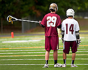 (Ellen Harasimowicz for The Boston Globe) Boston College High School's Ian Yanulis was literally on Westford Academy sophomore Jay Drapeau all day  holding the Grey Ghost sophomore to only two goals, five shy of the 100 mark for the season.
