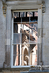 © Licensed to London News Pictures. 30/04/2015. Surrey, UK. Damage to the house can bee seen through windows. Fire officers at the scene of the fire today 30 April 2015. A fire at the National Trust-run Clandon Park House, near Guildford, is thought to have started in the basement just after 16:00 BST on Wednesday. Photo credit : Stephen Simpson/LNP