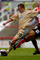 Photo: Catrine Gapper.<br /> Brentford v Bristol City. Coca Cola League 1.<br /> 24/09/2005.<br /> Brenford's Darren Pratley dangerously tackles Bristol's Scott Brown, earning himself a yellow card and gicing Bristol a free kick leading to second goal.