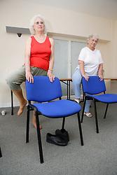 Older women taking part in a keep fit class,