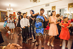 "Global Program Director, Rodney Lopez, leads students and their loved ones in dancing ""The Stomp"" a fun way for everyone to dance together.  Dancing Classrooms Virgin Islands culminating event at the Government House Ballroom in Christiansted.  St. Croix, USVI.  18 December 2015.  © Aisha-Zakiya Boyd"
