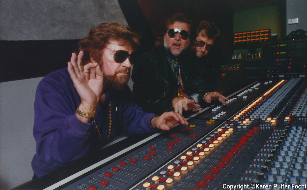 April  15,1992- Record producer Sam Phillips (left) sits at a recording control board with his sons, Knox and Jerry. (Photo by Karen Pulfer Focht)