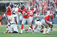 Ole Miss Rebels defensive end C.J. Johnson (10) celebrates a tackle of Mississippi State Bulldogs quarterback Dak Prescott (15) at Vaught-Hemingway Stadium in Oxford, Miss. on Saturday, November 29, 2014.