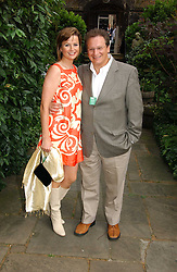P Y GERBEAU and his wife  TV presenter KATE SANDERSON at the annual Macmillan Cancer Support House of Lords vs the House of Commons Tug of War held in Victoria Tower Gardens on 20th June 2006.<br /><br />NON EXCLUSIVE - WORLD RIGHTS