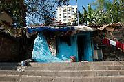 Small home on the steps of Banganga Tank, Mumbai.