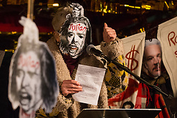 London, UK. 5 November, 2019. Fashion designer Vivienne Westwood addresses supporters of the Don't Extradite Assange Campaign assembled outside the Home Office to protest against the extradition of Wikileaks whistleblower Julian Assange to the United States. Rapper M.I.A. performed at the protest and the other speakers included Assange's father John Shipton.
