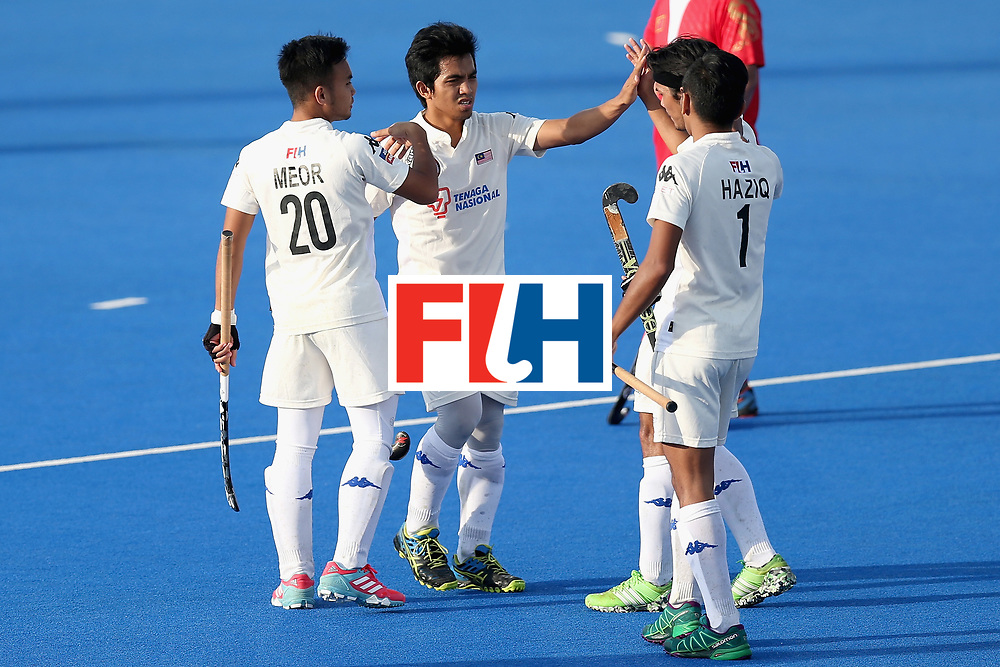 LONDON, ENGLAND - JUNE 20:  Fitri Saari of Malaysia celebrates scoring his sides fifth goal during the Pool A match between China and Malaysia on day six of the Hero Hockey World League Semi-Final at Lee Valley Hockey and Tennis Centre on June 20, 2017 in London, England.  (Photo by Alex Morton/Getty Images)